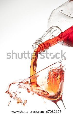 Splashing red drink isolated on the white - stock photo