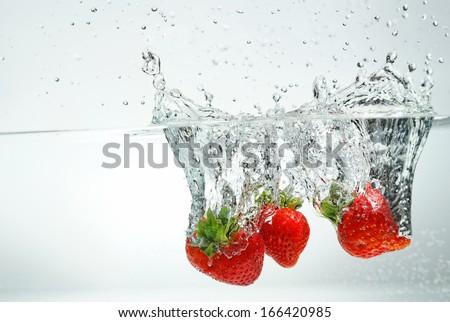 Splashing Strawberry - stock photo