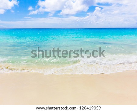 Splashing Tide Beach - stock photo