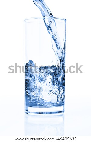 Splashing water in glass isolated on white