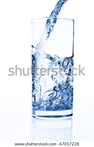 Splashing water in glass isolated on white - stock photo