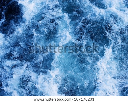 Splashing water waves shot from directly above - stock photo