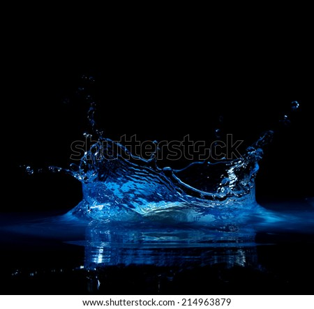 splashing water with high resolution on a black background - stock photo
