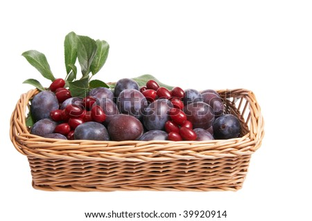 Splendid brown basket full of autumn fruits isolated on a white background.