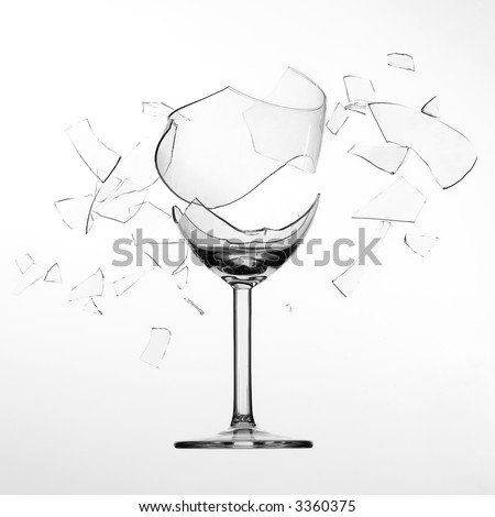 splintering, broken wine glass - stock photo