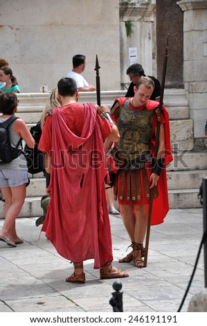 SPLIT, CROATIA - AUGUST 26: Men dressed as Roman soldiers for tourists in the Old Town of Split, Croatia. Split's Old Town is a UNESCO World Heritage Site. On August 26, 2014 in Split, Croatia