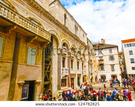 Split, Croatia - May 08, 2014: Tourists walk in the Old City on a cloudy summer day