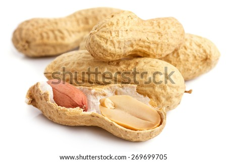 Split open peanut shells with nuts visible. - stock photo