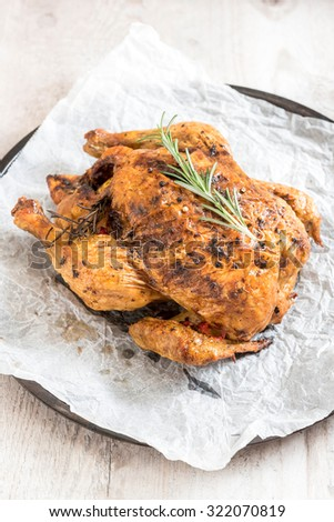 Split roasted stuffed chicken,selective focus - stock photo