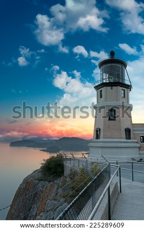 Split Rock Lighthouse Sunset with Moon in Two Harbors, Minnesota - stock photo