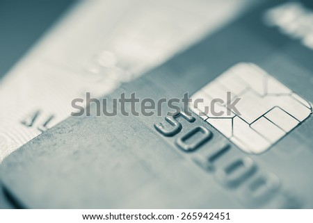 Split toned image of credit cards up close