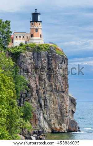Splitrock historical lighthouse on the cliff over Lake Superior - stock photo