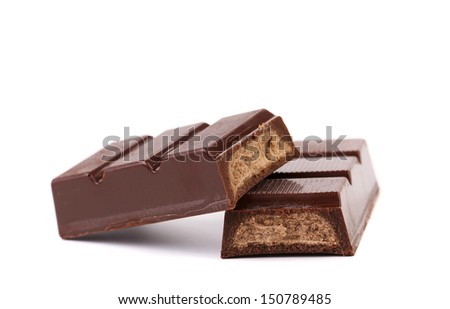 Splitted chocolate sticks with fillihg. White background.