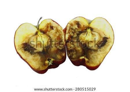 Spoiled apple on white background - stock photo