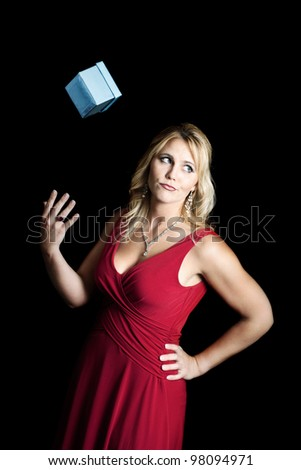 Spoiled woman throwing away a gift - stock photo