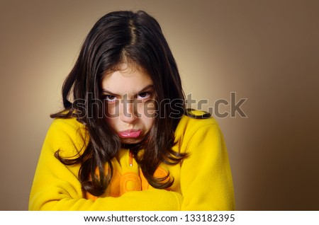 Spoiled young girl with pouty expression and being very stubborn - stock photo