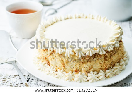 Sponge cake with butter cream on a white background. the toning. selective focus - stock photo