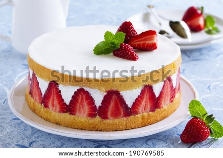 Sponge cake with strawberries and vanilla cream. - stock photo