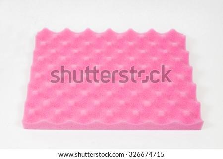Sponge cushioning pink color on white background - stock photo