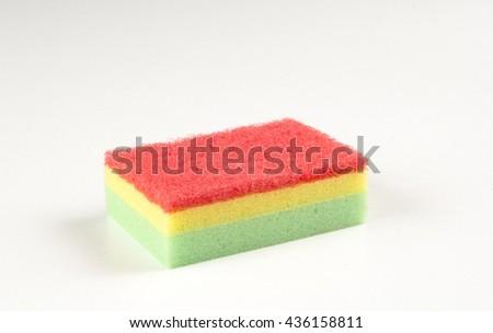 Sponge for dishes, sponge on a white background - stock photo