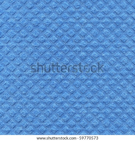 Sponge for washing dishes as a backdrop - stock photo