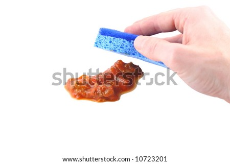 sponge wiping up spaghetti spill on white background - stock photo