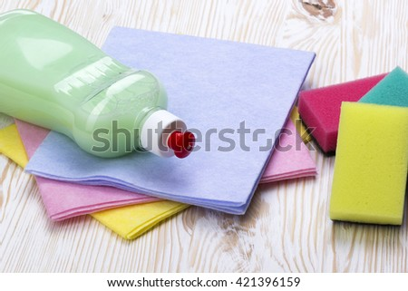 sponges, rags and a bottle of detergent - stock photo