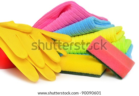 Sponges, towels and rubber gloves isolated  on the white background
