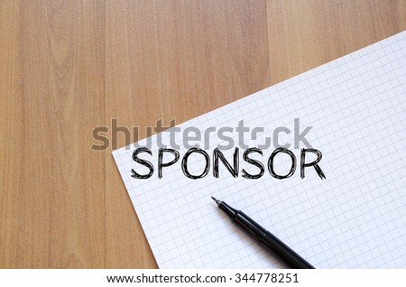 Sponsor text concept write on notebook with pen - stock photo