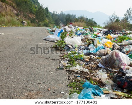 Spontaneous garbage dump along the road in Vietnam - stock photo