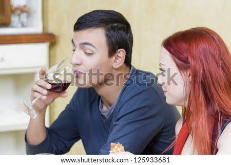 Spontaneous scene from restaurant - Young couple at the restaurant - stock photo