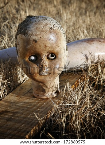 Spooky abandoned old doll - stock photo