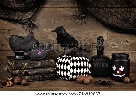 Spooky Black Halloween Decor Against An Old Rustic Wood Background