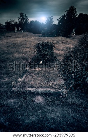 Spooky cemetery at midnight - stock photo