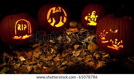 spooky glowing jack-o-lanterns - stock photo