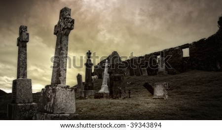 Spooky graveyard surrounding ancient ruin on Isle of Skye, Scotland - stock photo