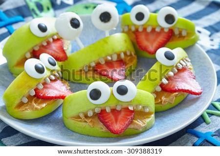 Spooky green apple monsters for Halloween party  - stock photo
