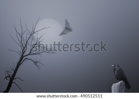 Spooky halloween background with dead tree, crow and bat