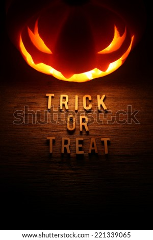 Spooky Halloween background with jack o lantern - Trick or Treat - stock photo
