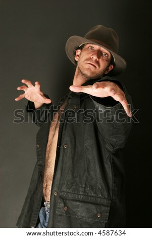 Spooky looking man in trench coat - stock photo