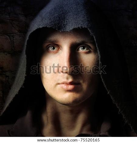 Spooky man in black hood - stock photo