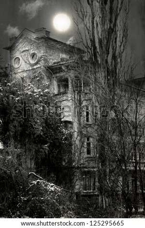 spooky old house with super moon in the sky- vintage background - stock photo