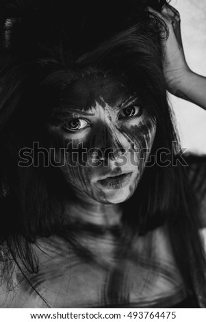 Spooky portrait of the woman. Demon theme on Halloween. Black-and-white Version of the Image