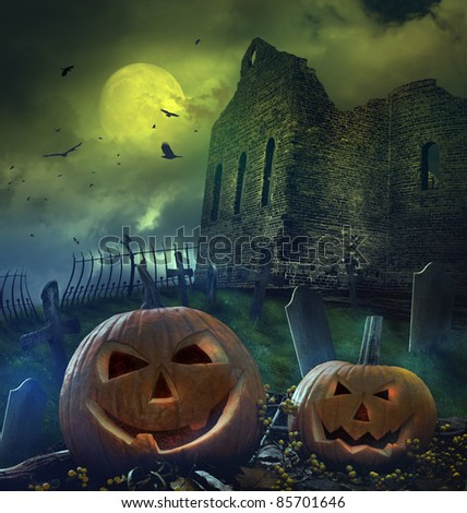 Spooky pumpkins in graveyard with church ruins - stock photo