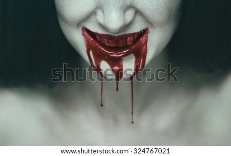 Spooky woman smiling, mouth of woman in blood. Halloween or horror theme