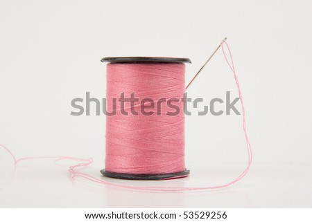 Spool of Pink Cotton Thread - stock photo