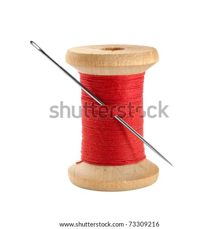 Spool of thread and needle - stock photo