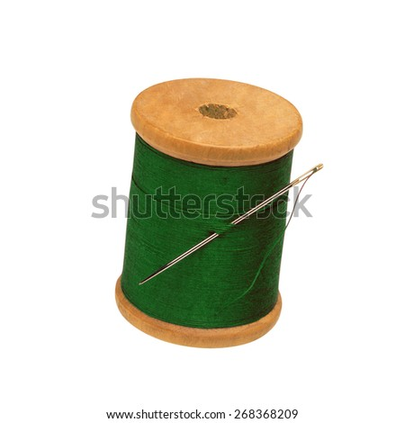 Spool of thread and needle isolated - stock photo