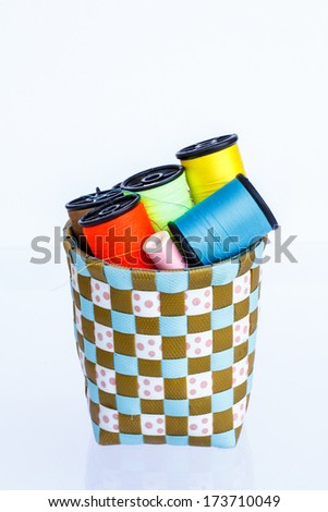 Spool of thread and needle on a white background - stock photo