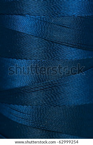Spool of thread background, texture - stock photo